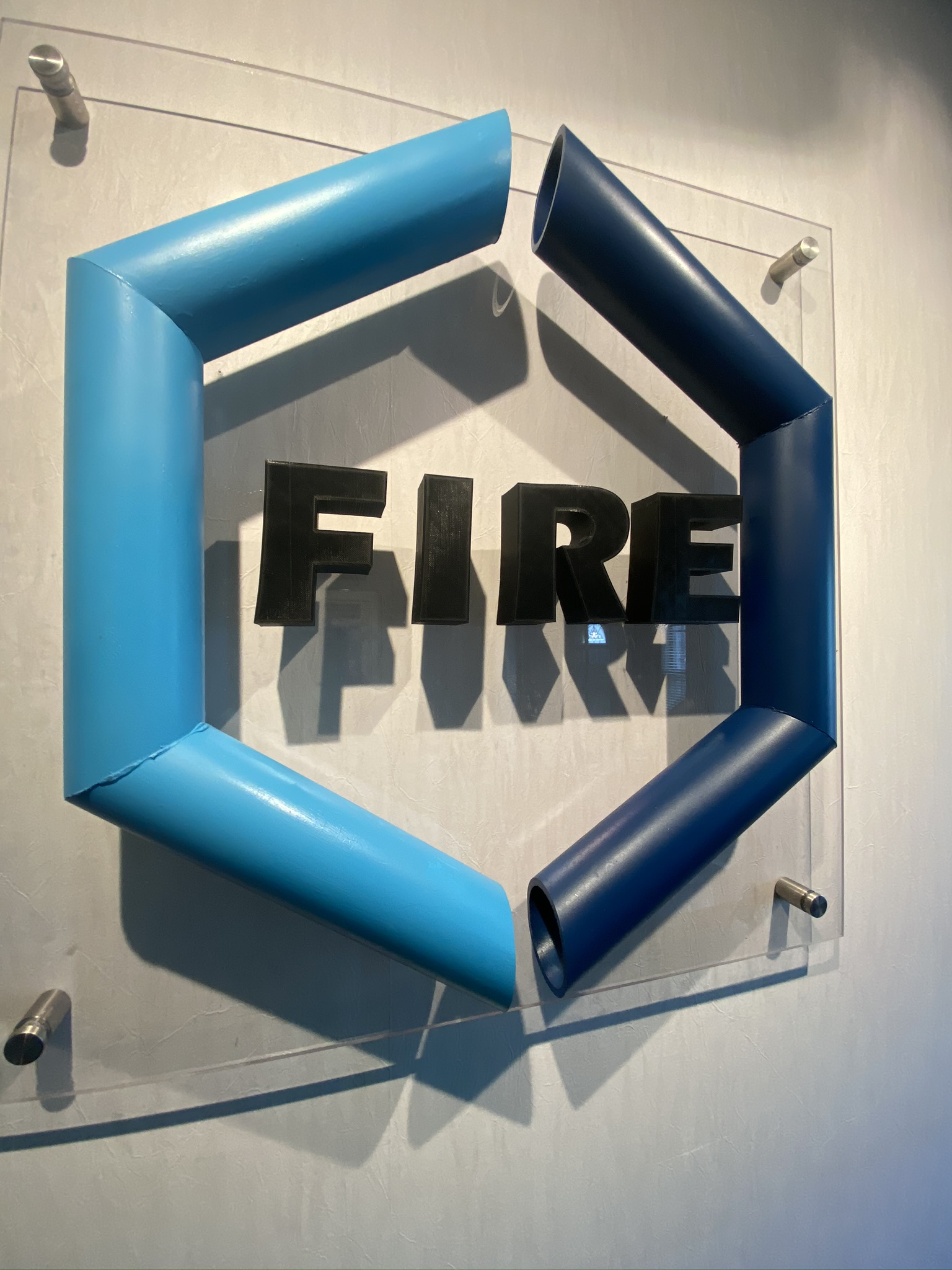 Fourte International Real Estate's FIRE logo displayed on a wall